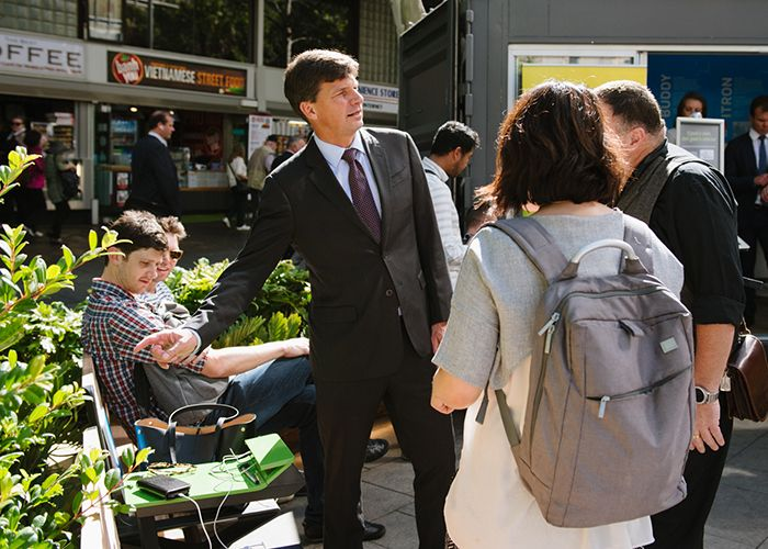 Assistant Minister for Cities Angus Taylor checks out PowerMe wifi charging tables at the official opening of Future Street. Photo: WE-EF.