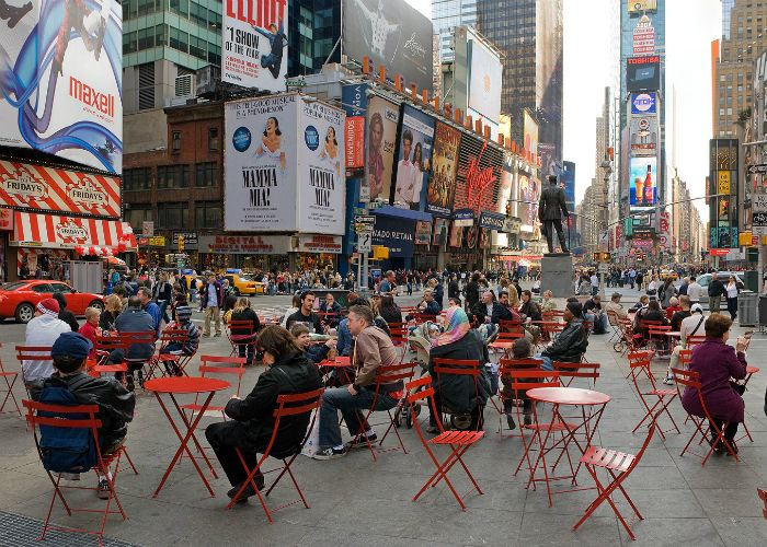Movable seats allow locals and visitors to mingle in New York's Times Square.