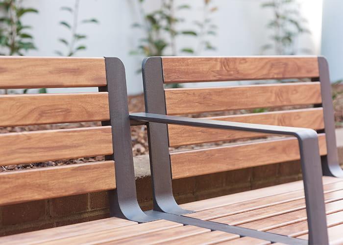 Aria Seat (CMA1) with arm, aluminium woodgrain battens in Spotted Gum, Textura Monument frame.