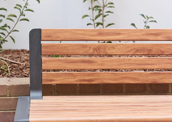 Aria Seat, woodgrain aluminium battens in Spotted Gum, frame in Textura Monument.